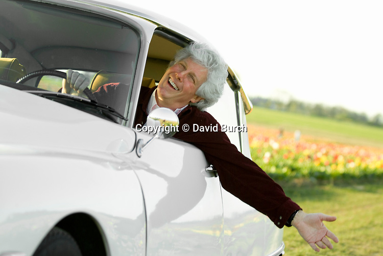 Man in car, smiling