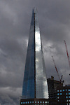 London's Shard tower as it nears completion just prior to opening in June 2012 under a dramatic sky.