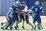 Torrance, CA 09/05/13 - \nj9\ and unidentified Peninsula player(s) in action during the Peninsula vs North Junior Varsity football game played at North High School in Torrance, California.