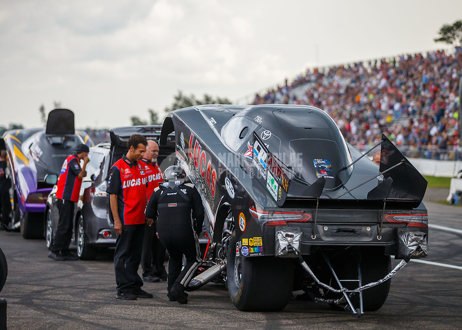 Aug 18, 2017; Brainerd, MN, USA; Crew members for NHRA funny car driver Del Worsham during qualifying for the Lucas Oil Nationals at Brainerd International Raceway. Mandatory Credit: Mark J. Rebilas-USA TODAY Sports