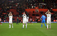 Pictured L-R: Jordi Amat, Angel Rangel and Federico Fernandez thank their away supporters after the final whistle Sunday 01 February 2015<br />