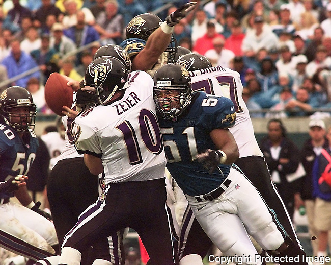 ....Jacksonville Jaguars linebacker Kevin Hardy (51) sacks Baltimore Ravens quarterback Eric Zeier during third quarter action at Alltel Stadium in Jacksonville, Fla., Sunday, Nov.  30, 1997.(Brian Myrick)..PHOTO 3 CITY .......Camera:   NC.^åPG         .Serial #:   4153288.Width:    1268.Height:   1012.Date:   11/30/97.Time:   16:12:55.Counter:    [78].ISO:        640 .Aperture:   F5.6.Shutter:    640 .Lens (mm):  300 .Exposure:   S   .Program:    HF  .Exp Comp:    0.0.Meter area: Cntr.Flash sync: Norm.Drive mode: H   .Focus mode: C   .Focus area: Wide.Distance:   ??  .