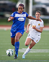 In a National Women's Soccer League Elite (NWSL) match, the Boston Breakers defeated the Western New York Flash  2-1, at Dilboy Stadium on May 5, 2013.  Boston Breakers midfielder Mariah Nogueira (20) dribbles the ball down the wing.