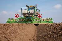 Cultivating for potatoes applying nematicide - Lincolnshire, April
