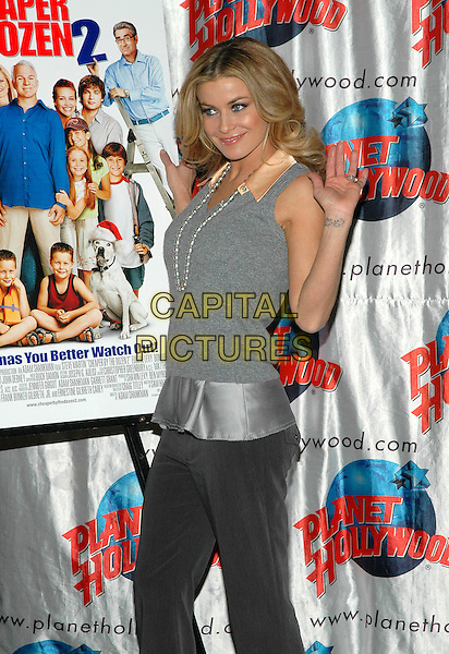 "CARMEN ELECTRA.Promotes her new film, ""Cheaper By The Dozen 2"" at Planet Hollywood in Times Square in New York City. .December 19th, 2005.Photo: Patti Ouderkirk/AdMedia/Capital Pictures.Ref: PO/ADM.half length grey gray vest pearl necklace hand waving tattoo.www.capitalpictures.com.sales@capitalpictures.com.© Capital Pictures."