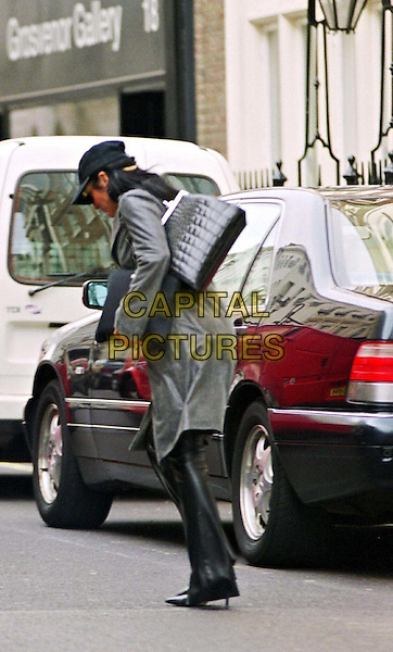 NANCY DELL'OLIO.In Mayfair.paparazzi picture, baseball cap, grey coat, gray coat, full length, full-length.www.capitalpictures.com.sales@capitalpictures.com.© Capital Pictures