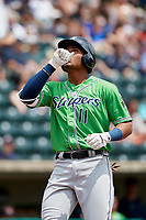 Gwinnett Stripers first baseman Carlos Franco (11) celebrates as he crosses home plate after hitting a home run in the top of the seventh inning during a game against the Columbus Clippers on May 17, 2018 at Huntington Park in Columbus, Ohio.  Gwinnett defeated Columbus 6-0.  (Mike Janes/Four Seam Images)