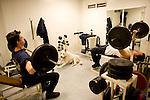 Paris, France. 1er Mai 2009..Brigade Fluviale de Paris..Quai Saint Bernard (5eme arrondissement).00h15 En entrainement de musculation...Paris, France. May 1st 2009..Paris fluvial squad..Quai Saint Bernard (5th arrondissement).00:15 am In the weights room.