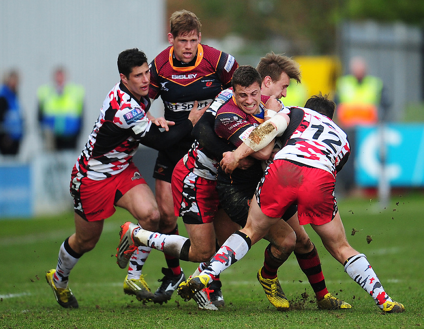 Dragons' Dorian Jones is tackled by Edinburgh's Tom Brown<br /> <br /> Photographer Kevin Barnes/CameraSport<br /> <br /> Rugby Union - Guinness PRO12 Round 18 - Newport Gwent Dragons v Edinburgh Rugby - Sunday 27th March 2016 - Rodney Parade - Newport<br /> <br /> &copy; CameraSport - 43 Linden Ave. Countesthorpe. Leicester. England. LE8 5PG - Tel: +44 (0) 116 277 4147 - admin@camerasport.com - www.camerasport.com