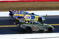 Mar 19, 2017; Gainesville , FL, USA; NHRA funny car driver Alexis DeJoria (near) races alongside Ron Capps during the Gatornationals at Gainesville Raceway. Mandatory Credit: Mark J. Rebilas-USA TODAY Sports