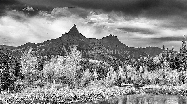 Pilot and Index Peaks tower above an autumn landscape outside of Yellowstone.<br />