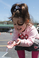 NWA Democrat-Gazette/CHARLIE KAIJO Willow Senasy, 3, of Branson, Mo. plays with bubbles, Sunday, April 14, 2019 at the farmer's market in Bella Vista. Attendees enjoyed shopping for local food and goods at Bella Vista's first farmer's market of the 2019 season.