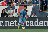 FOXBOROUGH, MA - SEPTEMBER 29: Eric Miller #5 of New York City FC dribbles during a game between New York City FC and New England Revolution at Gillette Stadium on September 29, 2019 in Foxborough, Massachusetts.