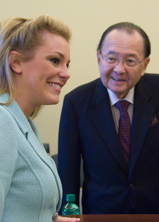 "Chairman Daniel Inouye, D-HI., greets Miss America 2007 Lauren Nelson before the start of the Senate Commerce, Science and Transportation Committee Child Internet Protection full committee hearing on ""Protecting Children on the Internet.."