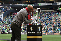 SEATTLE, WA - NOVEMBER 10: Toronto FC legend Danny Dichio kisses the Philip F. Anschutz Trophy after helping to take it onto the field during a game between Toronto FC and Seattle Sounders FC at CenturyLink Field on November 10, 2019 in Seattle, Washington.