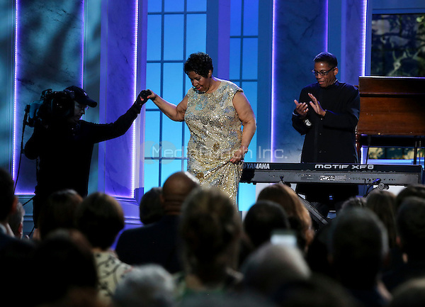 Aretha Franklin leaves the stage with with the help of a cameraman after paying with Herbie Hancock (R) at the International Jazz Day Concert on the South Lawn of the White House, in Washington, DC, April 29, 2016. United States President Barack Obama delivered remarks to introduce the event. <br /> Credit: Aude Guerrucci / Pool via CNP/MediaPunch