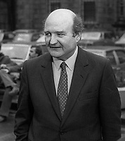 Barry Desmond, TD, Labour Party, politician, Rep of Ireland, pictured arriving Leinster House for the opening of the recently-elected Dail Eireann, Irish Parliament, 14th December 1982, 198212140319BD<br /> <br /> Copyright Image from Victor Patterson, 54 Dorchester Park, <br /> Belfast, UK, BT9 6RJ<br /> <br /> t1: +44 28 9066 1296 (from Rep of Ireland 048 9066 1296)<br /> t2: +44 28 9002 2446 (from Rep of Ireland 048 9002 2446)<br /> m: +44 7802 353836<br /> <br /> victorpatterson@me.com<br /> www.victorpatterson.com<br /> <br /> Please see my Terms and Conditions of Use at VICTORPATTERSON.COM. It is IMPORTANT that you familiarise yourself with them.<br /> <br /> Images used on the Internet must be visibly watermarked i.e. &copy;VICTORPATTERSON.COM within the body of the image and copyright metadata must not be deleted. Images used on the Internet have a size restriction of 4kbs and are chargeable at the then current NUJ rates.<br /> <br /> This image is only available for the use of the download recipient i.e. television station, newspaper, magazine, book publisher, etc, and must not be passed on to any third party. It is also downloaded on condition that each and every usage is notified within 7 days to victorpatterson@me.com<br /> <br /> The right of Victor Patterson to be identified as the author is asserted in accordance with The Copyright Designs And Patents Act (1988).
