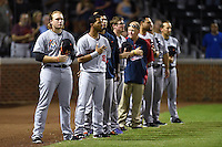 Salt River Rafters catcher Chad Wallach (29) and outfielder Eddie Rosario (16) lead the line for the national anthem before an Arizona Fall League game against the Mesa Solar Sox on October 18, 2014 at Cubs Park in Mesa, Arizona.  Mesa defeated Salt River 8-4.  (Mike Janes/Four Seam Images)