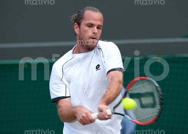 Xavier Malisse (BEL) plays against Sam Querrey (USA) on Court 1. The Wimbledon Championships 2010 The All England Lawn Tennis & Croquet Club  Day 6 Saturday 26/06/2010
