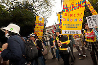 Activists carry banners calling for the release of Fumiaki Hoshino who was arrested in 1975 for the alleged killing of a police officer during riots in Tokyo and sentenced to life imprisonment at a Demo by left-wing activist groups and trade unions in Hibiya Park, Tokyo, Japan. Sunday November 3rd  2013