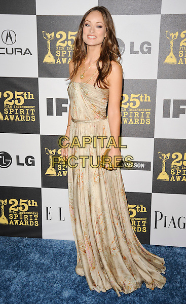 OLIVIA WILDE.The 25th Annual Film Independent Spirit Awards at the LA Live Event Deck in Los Angeles, California, USA..March 5th, 2010  .full length strapless beige gold print printed patterned pattern dress necklace clutch bag maxi.CAP/ROT.©Lee Roth/Capital Pictures