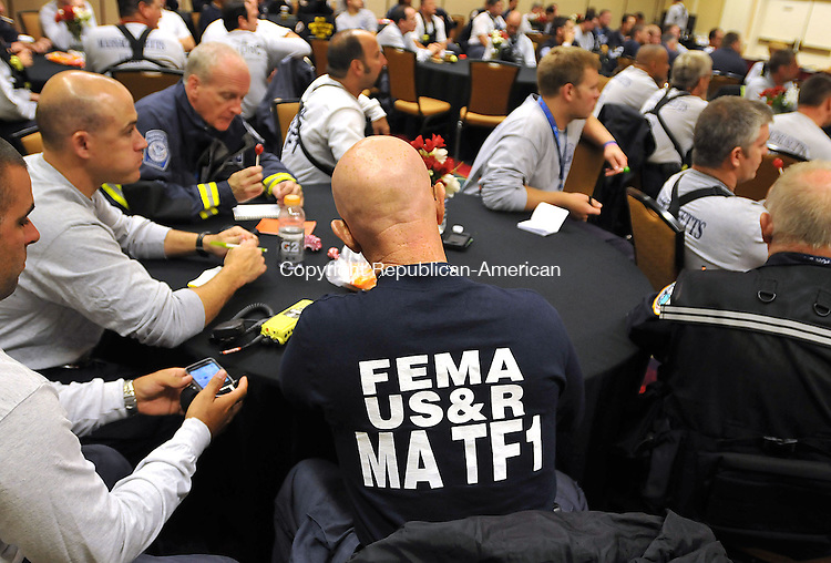 WATERBURY, CT, 28 AUGUST 2011-082811JS01--Members of the FEMA's Urban Search and Rescue operational team, listen during a briefing about Hurricane Irene Sunday morning at the Courtyard Marriott Hotel in Waterbury. <br /> Jim Shannon Republican-American