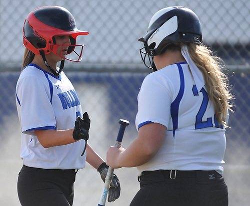 Catherine Zucker #3, North Babylon centerfielder, left, gets congratulated by pitcher Ava Shorr #22 after crossing home plate in the bottom of the third inning of a Suffolk County League V varsity softball game against West Islip at North Babylon High School on Wednesday, May 9, 2018. North Babylon won by a score of 4-1.