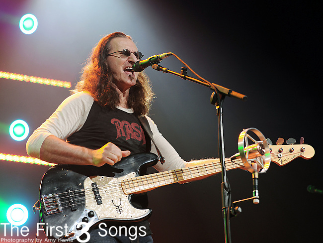 """Geddy Lee of Rush performs at the Nationwide Arena in Columbus, Ohio as part of their """"Time Machine Tour"""" on Sunday, August 29, 2010."""
