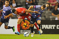 MELBOURNE, AUSTRALIA - JANUARY 23, 2010: Mathew Leckie from Adelaide United fights for the ball with Tom Pondeljak of Melbourne Victory in round 24 of the A-league match between Melbourne Victory and Adelaide United FC at Etihad Stadium on January 23, 2010 in Melbourne, Australia. Photo Sydney Low www.syd-low.com