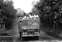 School children arrive at school in a pick-up truck. Community of Nueva Esperanza, El Salvador, 1999.