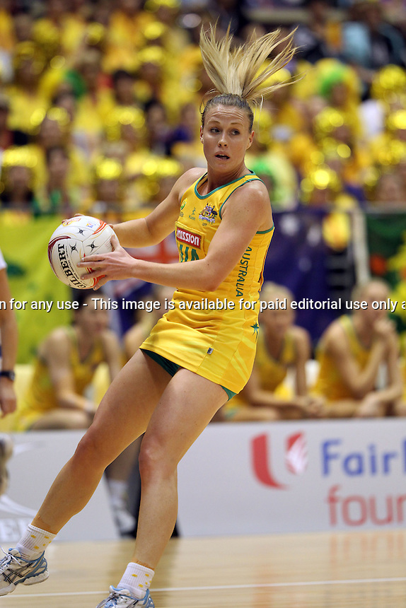 09.07.2011 Australia's Kimberely Green in action during the netball match between Jamaica and Australia at the Mission Foods World Netball Championship 2011 held at the Singapore Indoor Stadium in Singapore . Mandatory Photo Credit ©Michael Bradley.