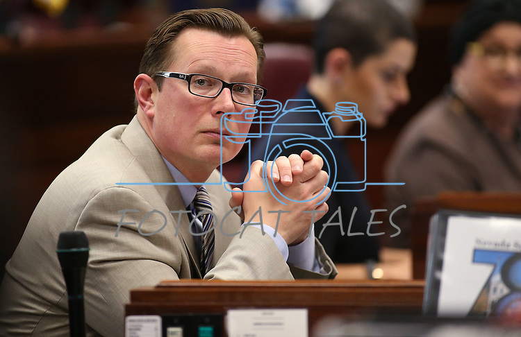 Nevada Sen. Ben Kieckhefer, R-Reno, works on the Senate floor at the Legislative Building in Carson City, Nev., on Tuesday, April 28, 2015. <br /> Photo by Cathleen Allison