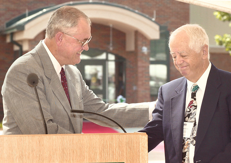 President of Ohio University Robert Glidden congratulates Dr. Richard McFarland