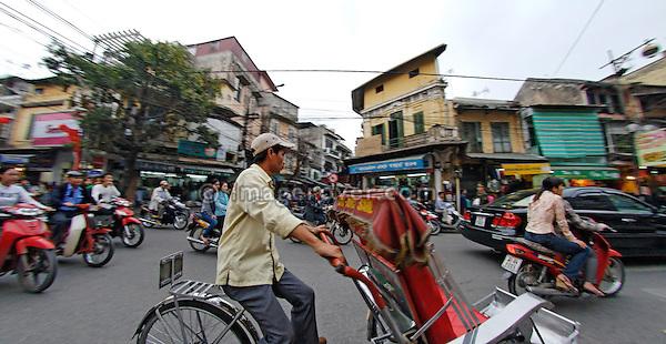 Asia, Vietnam, Hanoi. Hanoi old quarter. Cyclo driver.