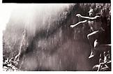 USA, Hawaii, Oahu, jumping into the water at Sacred Falls