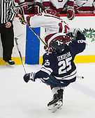 Chris Izmirlian (Yale - 25), Adam Fox (Harvard - 18) - The Harvard University Crimson defeated the Yale University Bulldogs 6-4 in the opening game of their ECAC quarterfinal series on Friday, March 10, 2017, at Bright-Landry Hockey Center in Boston, Massachusetts.