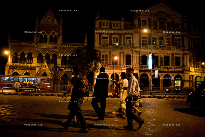 A group of jewish people walk past the David Sassoon Library in Mumbai, India. Mumbai used to have a thriving community of jewish settlers but their numbers are now dwindling. The city still boasts a number of well preserved schools, synagogues and community centers that are still in use. The jewish and muslim community in bombay is intricately intertwined. Photo by Suzanne Lee