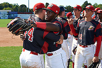 Batavia Muckdogs Jarett Rindfleisch (44) hugs Isaiah White (18) as Corey Bird (12) looks on after a game against the Auburn Doubledays on September 5, 2016 at Dwyer Stadium in Batavia, New York.  Batavia defeated Auburn 4-3. (Mike Janes/Four Seam Images)
