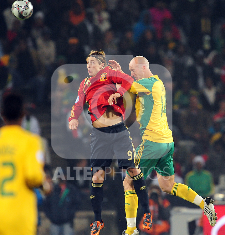 Torres and Matthew Booth  during the soccer match of the 2009 Confederations Cup between Spain and South Africa played at the Freestate Stadium,Bloemfontein,South Africa on 20 June 2009.  Photo: Gerhard Steenkamp/Superimage Media.
