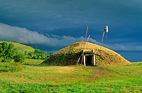 Earthlodge with approaching storm at On-A-Slant Village, in Fort Abraham Lincoln State Park, Mandan, North Dakota, AGPix_0321.