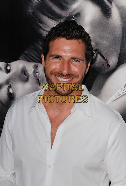 "ED QUINN .arriving at the Los Angeles premiere of Season 2 of the HBO series ""True Blood"" on the backlot at Paramount Pictures Studio in Hollywood, California, USA, June 9th 2009..portrait headshot white shirt smiling beard facial hair stubble  .CAP/ROT.©Lee Roth/Roth Stock/Capital Pictures."
