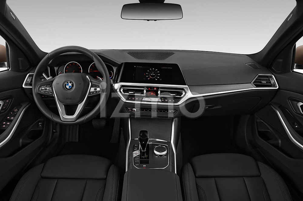 Stock photo of straight dashboard view of 2019 BMW 3-Series-Sedan 330i-Sport-Line 4 Door Sedan Dashboard