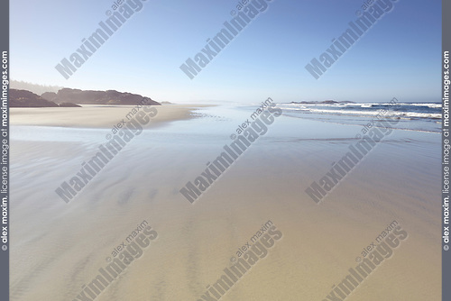 Surreal scenery of the sandy ocean shore at Pacific Rim National Park Reserve, Long Beach, Tofino, Vancouver Island, BC, Canada. Image © MaximImages, License at https://www.maximimages.com