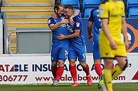 Jack Marriott of Peterborough United celebrates with Ricky Miller of Peterborough United after he scores the opening goal of the game during the Sky Bet League 1 match between Peterborough and Oxford United at the ABAX Stadium, London Road, Peterborough, England on 30 September 2017. Photo by David Horn.