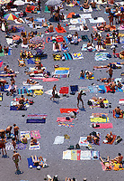 Summer bathers crowd the beach in Positano, Italy