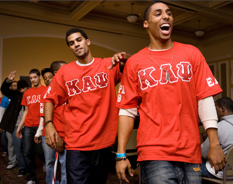 "Jordan Penn, left and Victor Moore lead the line during a ""step"" and a ""stroll"" through the audience during the BSCPB (Black Student Cultural Programming Board) Sibs Variety Show Friday evening at Baker Center. They are from Kappa Alpha Psi."