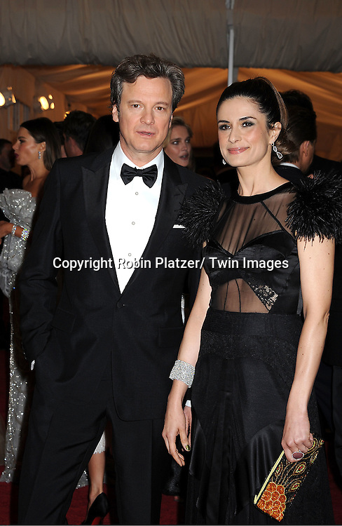 "Colin Firth and wife Livia Firth attends the Costume Institute Gala Benefit celebrating ""Schiaparelli and Prada: Impossible Conversations"".an exhibition at the Metropolitan Museum of Art in New York City on May 7, 2012."