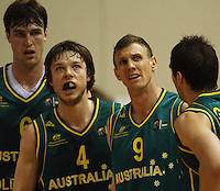 Australia's AJ Ogilvy, Matthew Dellavedova and Peter Crawford look up at the scoreboard during the International basketball match between the NZ Tall Blacks and Australian Boomers at TSB Bank Arena, Wellington, New Zealand on 25 August 2009. Photo: Dave Lintott / lintottphoto.co.nz