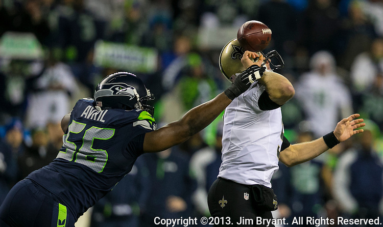 Seattle Seahawks  defensive end Chris Avril (56) strips New Orleans Saints quarterback Drew Brees (8) of the ball during the first quarter at CenturyLink Field in Seattle, Washington on December 2, 2013. Seahawks defensive end Michael Bennett caught the ball and returned it for a touchdown. ©2013. Jim Bryant Photo. ALL RIGHTS RESERVED.