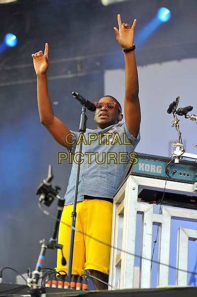 Labrinth (Timothy McKenzie).performing at V Festival, Hylands Park, Chelmsford, Essex, England. .18th August 2012.on stage in concert live gig performance music half length blue shirt yellow shorts sunglasses shades singing arms in air.CAP/MAR.© Martin Harris/Capital Pictures.